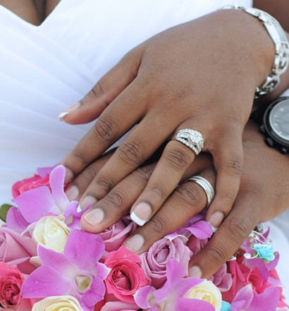 couple with wedding rings and bouquet