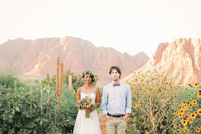 Man and Woman in field | Farm Fresh Style Wedding in Utah | Gideon Photography | Ultimate Wedding Magazine