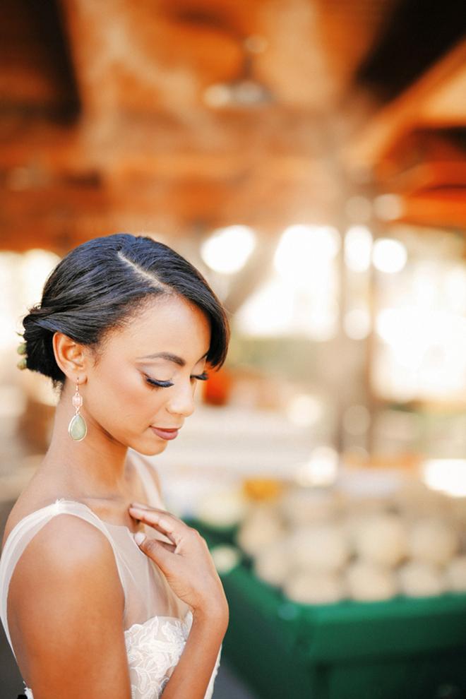 Bride outside vegetable stand | Farm Fresh Style Wedding in Utah | Gideon Photography | Ultimate Wedding Magazine