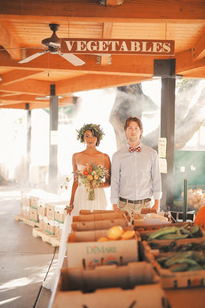 Couple by vegetable stand | Farm Fresh Style Wedding in Utah | Gideon Photography | Ultimate Wedding Magazine