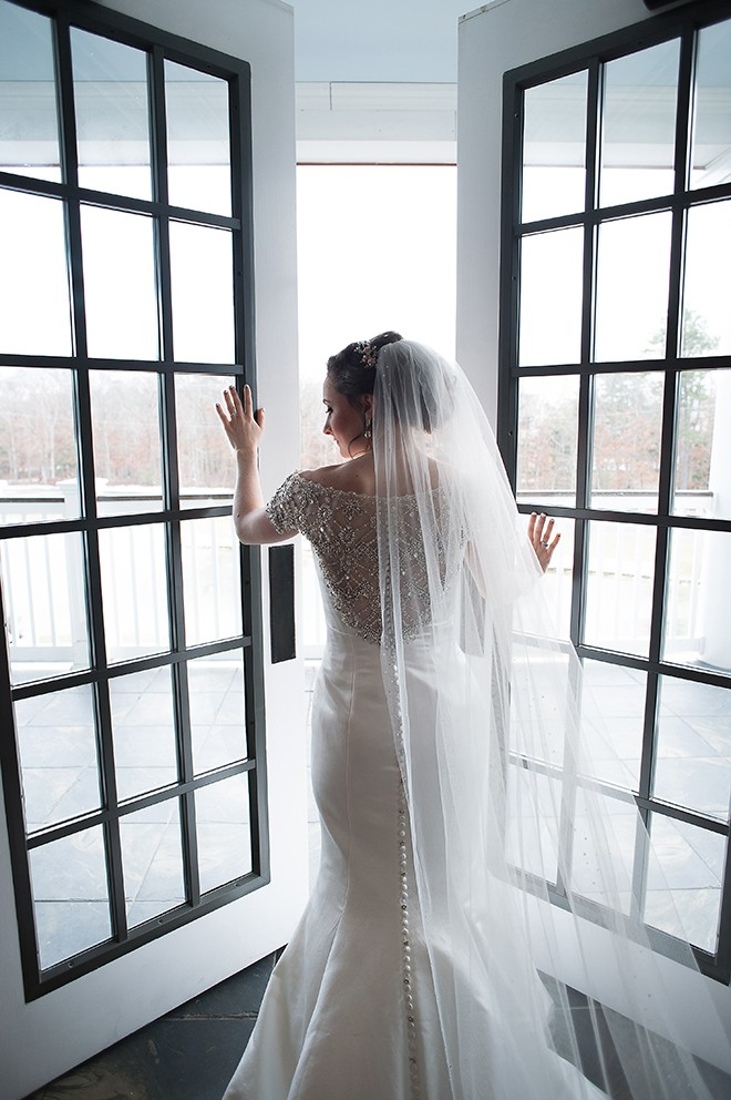 Bride in doorway | Regal Winter Wedding | Bokeh Love Photography