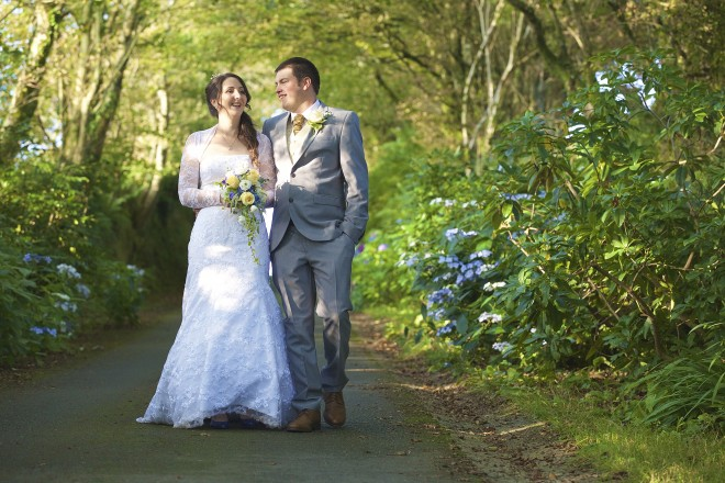 Married couple walking outside | Ta Mill Wedding Venue Offer