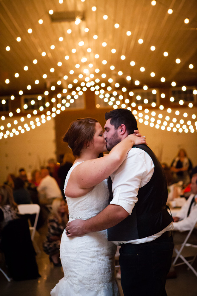 Wedding couple kissing | Barn Wedding in Ohio | Photos by Yvonne