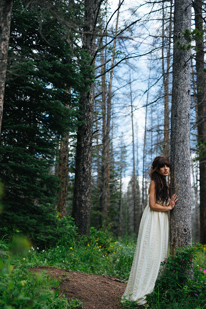 Bride wearing white dress standing in the woods | Where the wild things are | Elizabeth Cryan Photography