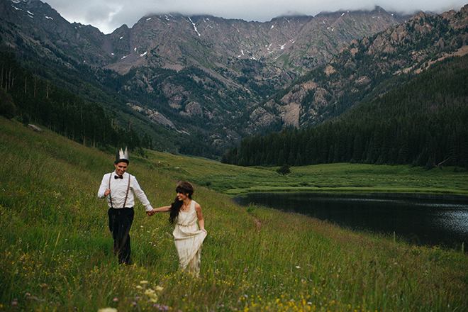 Bride and Groom walking through Piney River Ranch | Where the wild things are | Elizabeth Cryan Photography