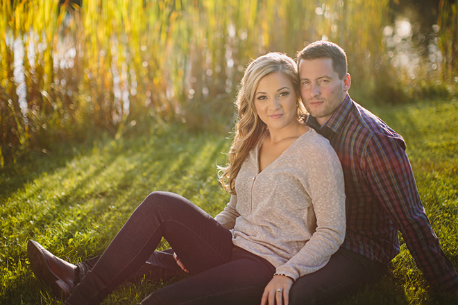 Couple sitting in field | Autumn Engagement in Alberta | Twitchy Finger Photography