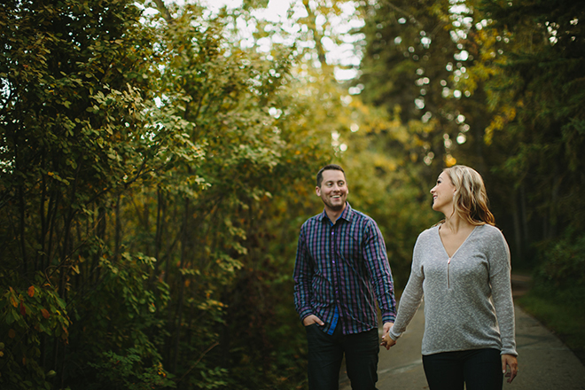 Couple walking through the woods | Autumn Engagement in Alberta | Twitchy Finger Photography