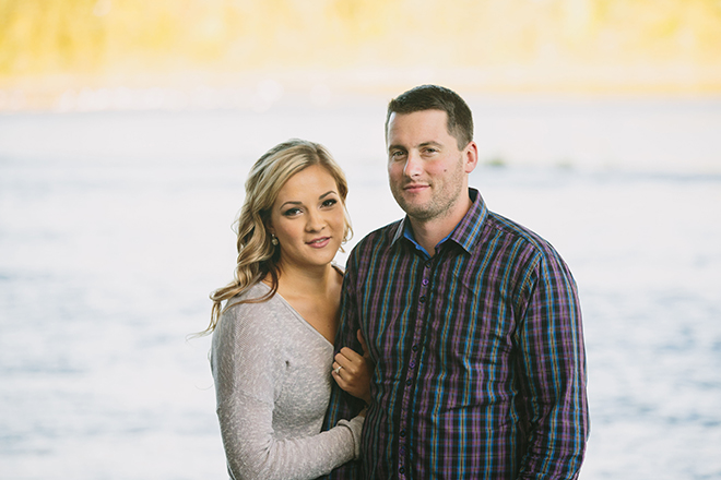 Couple standing by lake | Autumn Engagement in Alberta | Twitchy Finger Photography