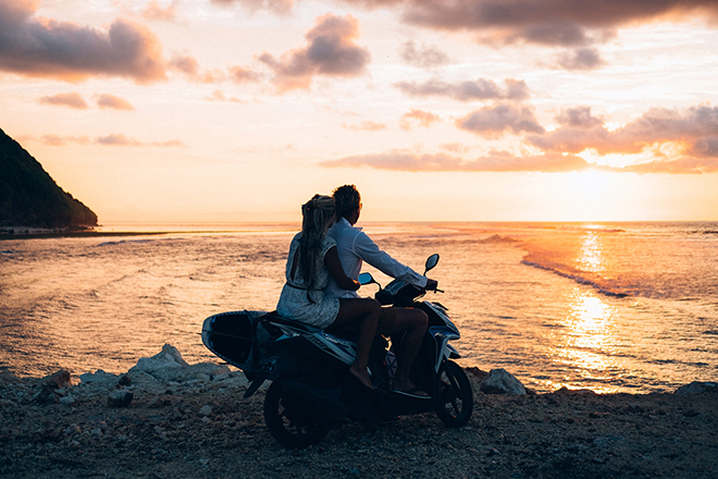 Couple on bikeBalinese Beach Surf Elopement | Emily & Steve Photography