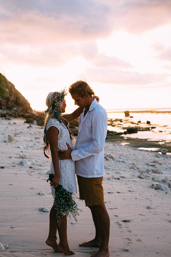 Bride and groom on beachBalinese Beach Surf Elopement | Emily & Steve Photography