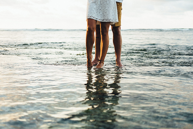 Couple standing in the seaBalinese Beach Surf Elopement | Emily & Steve Photography