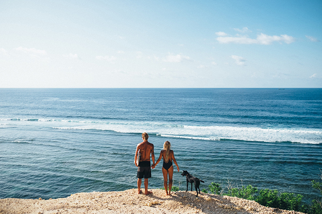 Bride and groom on cliff | Balinese Beach Surf Elopement | Emily & Steve Photography