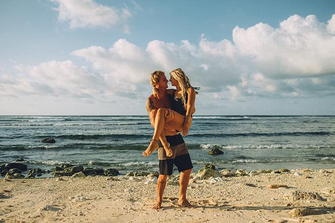 Surfing couple on beach | Balinese Beach Surf Elopement | Emily & Steve Photography