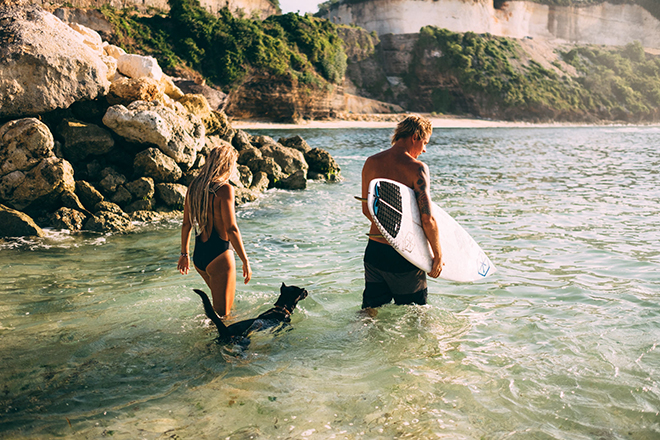 Surfers walking in the sea | Balinese Beach Surf Elopement | Emily & Steve Photography