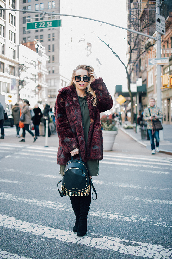 Young woman wearing faux fur in New York | City Honeymoon Fashion | Laurel Creative