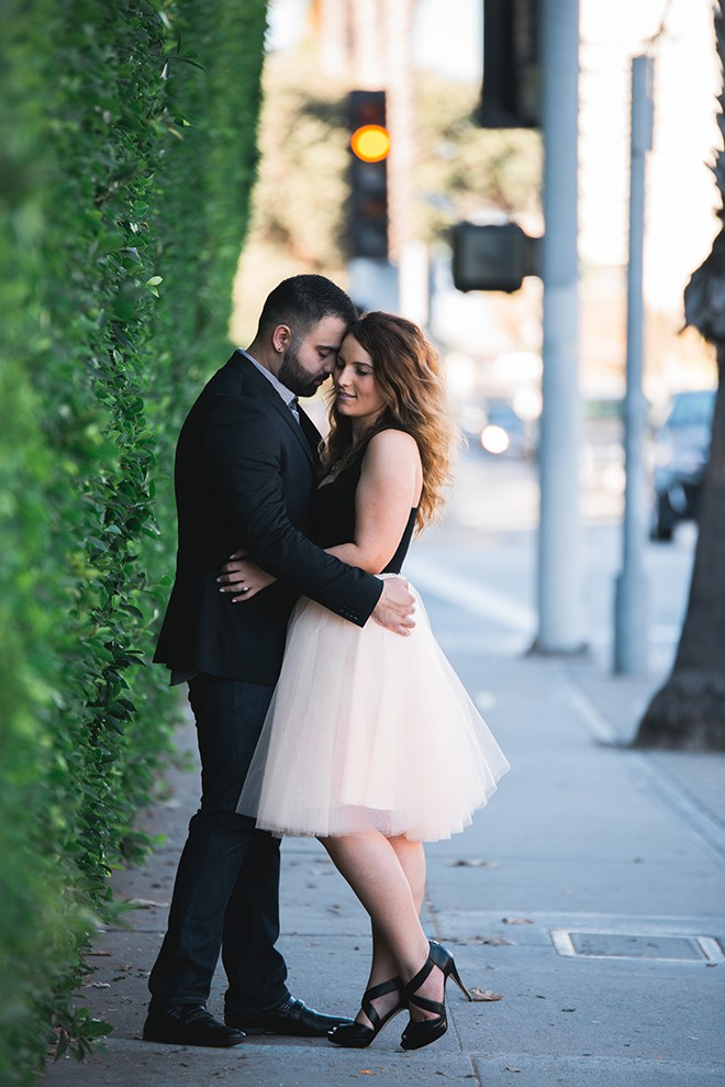 Engaged couple standing in the street | Engagement in Santa Monica | Randy + Ashley Photography