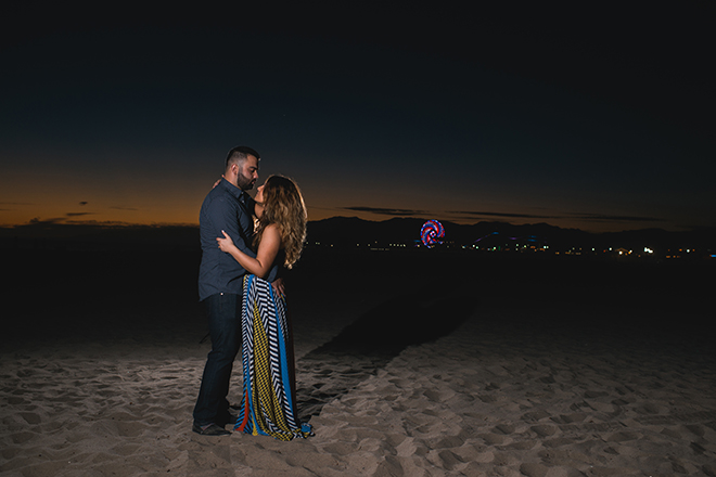Couple standing on beach at night | Engagement in Santa Monica | Randy + Ashley Photography
