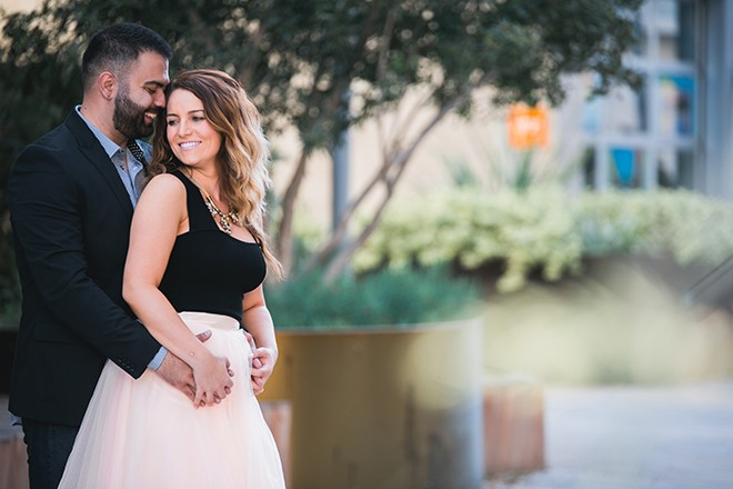 Standing by shrubbery | Engagement in Santa Monica | Randy + Ashley Photography