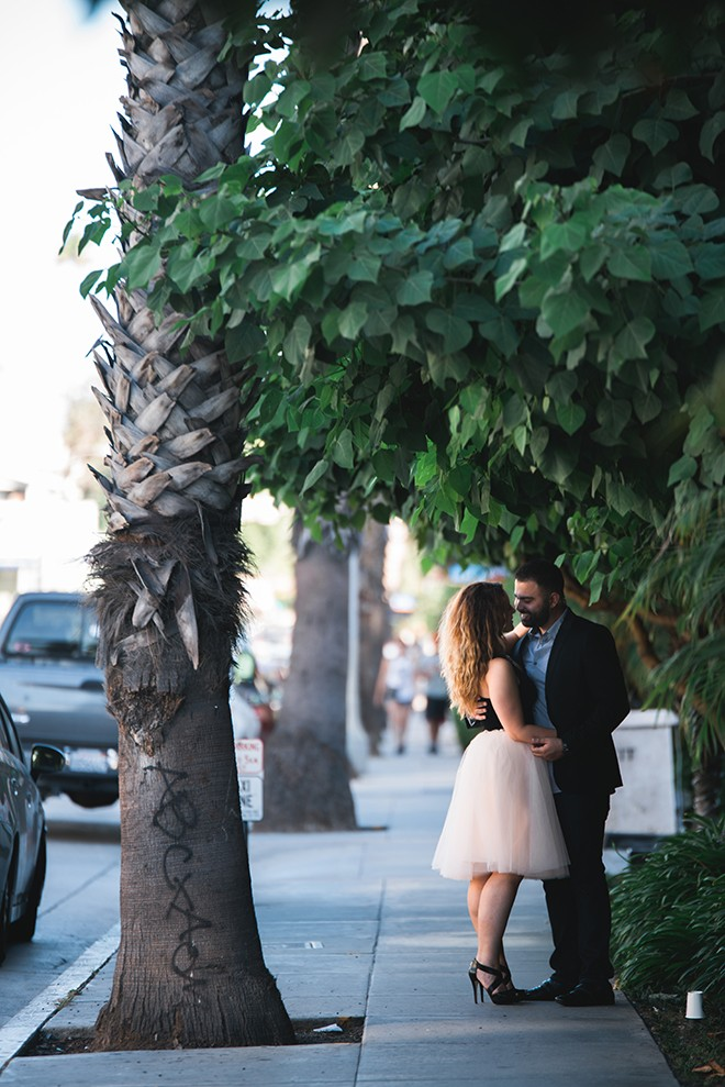 Engaged couple standing together | Engagement in Santa Monica | Randy + Ashley Photography