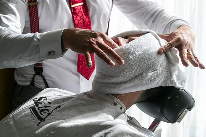Man at barber shaving | Grooming the groom | Michael Bennett Kress Photography