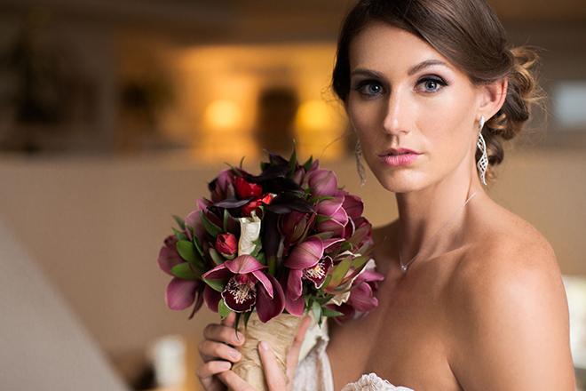 Bride holding purple bouquet | Opulent Romance | Mehta Weddings