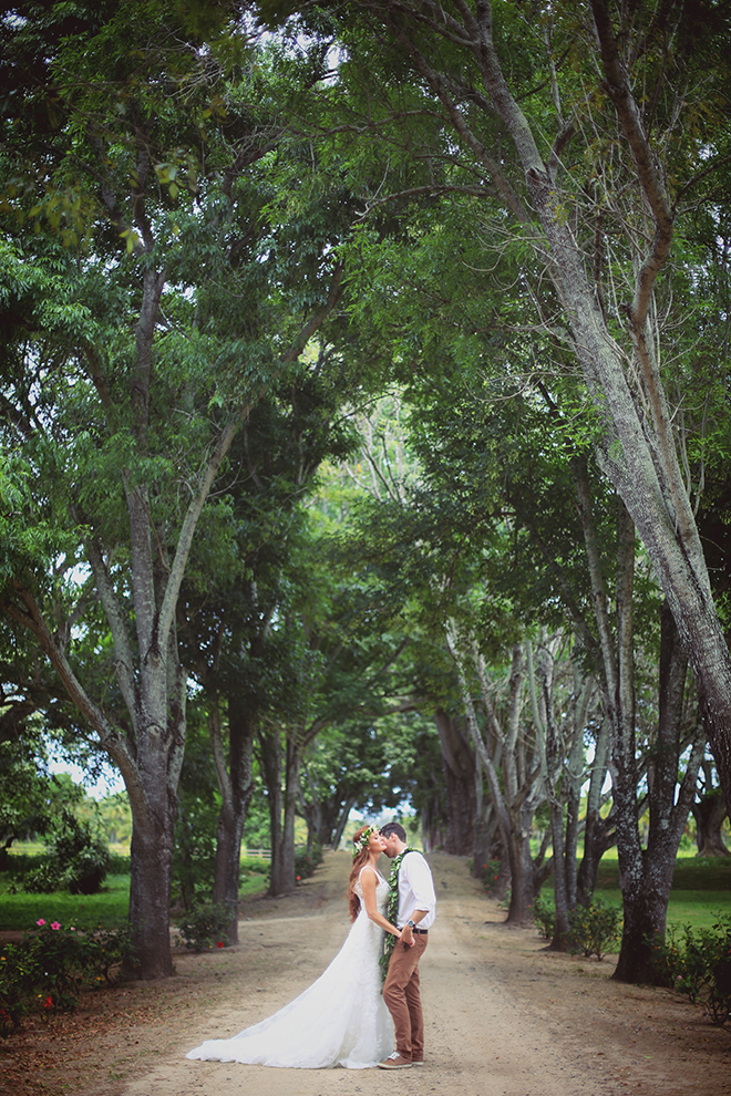 Bride and Groom standing in tree lined road | Paradise in Hawaii | Jenna Lee Pictures