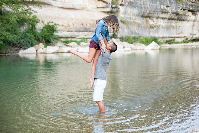 Man lifting woman into the airRiverside Engagement Shoot | Laura Elizabeth Photography