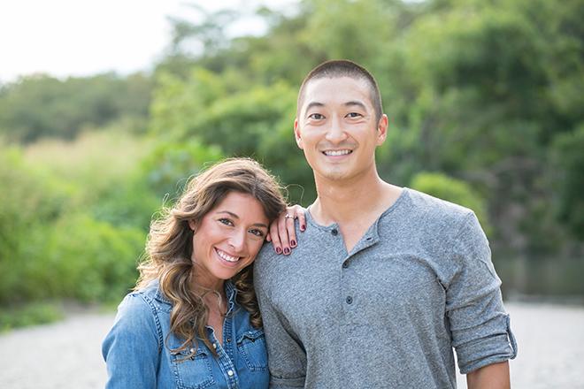 Engaged smiling coupleRiverside Engagement Shoot | Laura Elizabeth Photography