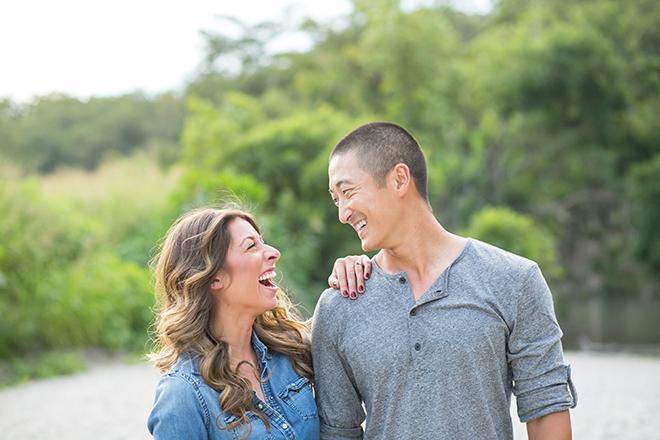 Engaged couple laughingRiverside Engagement Shoot | Laura Elizabeth Photography
