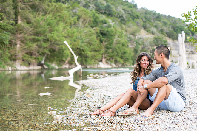 Man and woman sitting beside riverRiverside Engagement Shoot | Laura Elizabeth Photography