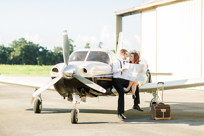 Man and woman sitting on aircraft wing | Vintage Airport Engagement | Ailyn La Torre Photography