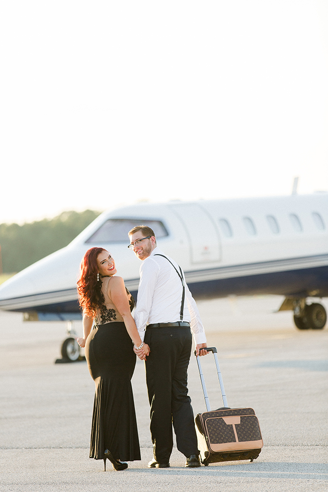 Engaged couple walking towards private jet | Vintage Airport Engagement | Ailyn La Torre Photography