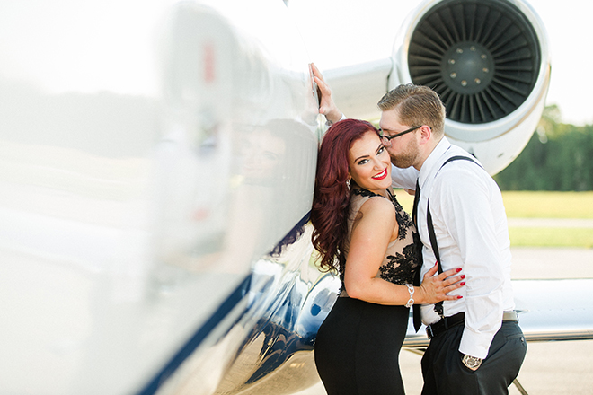 Engaged couple kissing beside aircraft | Vintage Airport Engagement | Ailyn La Torre Photography