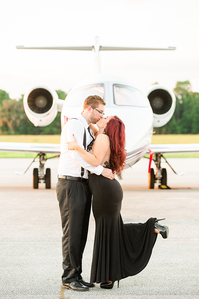 Kissing at the airport | Vintage Airport Engagement | Ailyn La Torre Photography