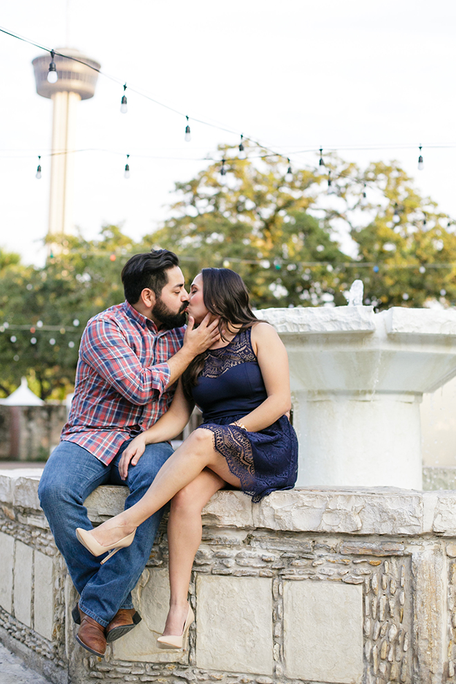 Couple sitting beside fountain | Downtown San Antonio Engagement | Laura Elizabeth