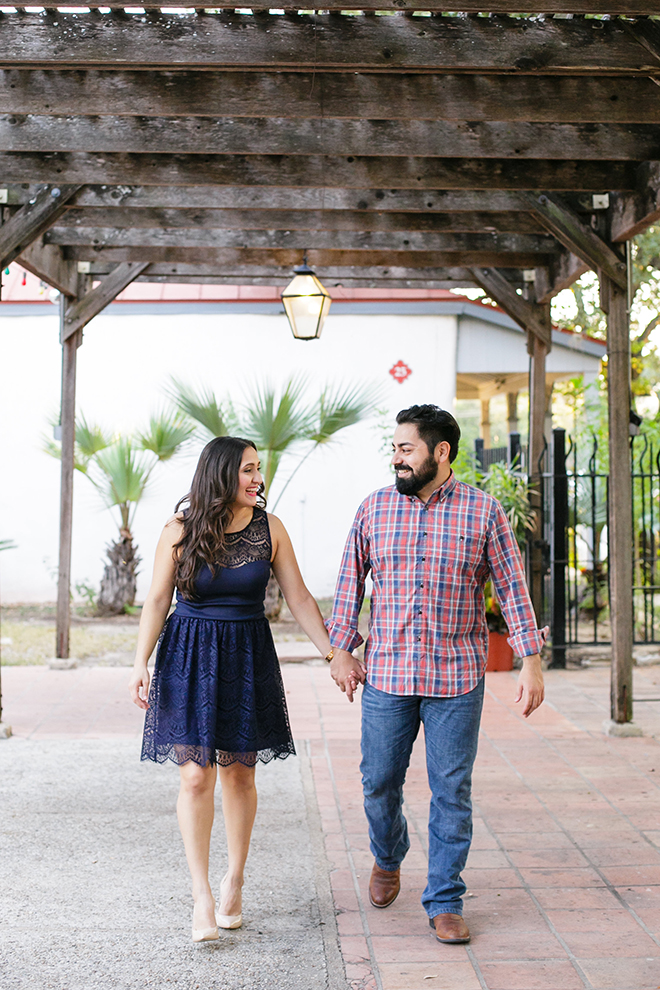 Couple walking in La Villita | Downtown San Antonio Engagement | Laura Elizabeth
