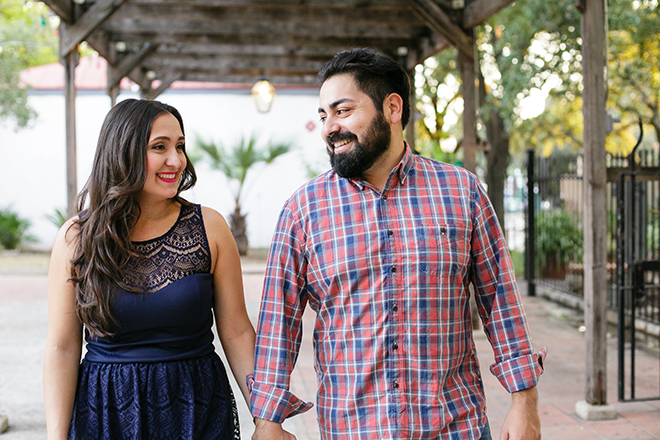 Man and woman walking in street | Downtown San Antonio Engagement | Laura Elizabeth