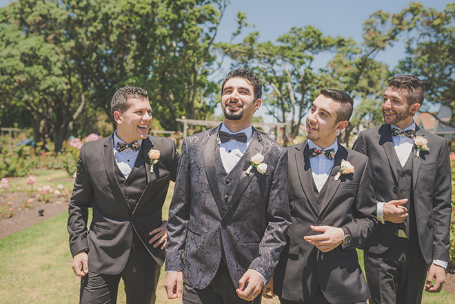 Grooms walking to wedding | Rose Garden Beach Wedding | Levien and Lens Photography