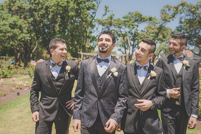 Grooms walking to wedding | Rose Garden Beach Wedding | Levien and Lens Photography