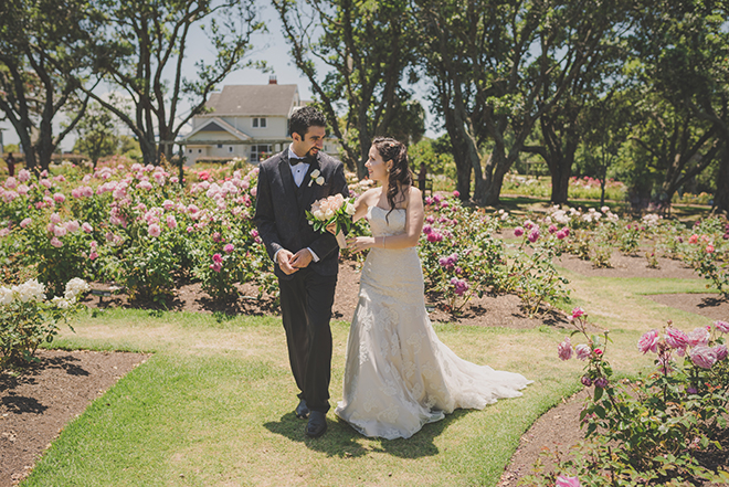 Couple walking to wedding reception | Rose Garden Beach Wedding | Levien and Lens Photography