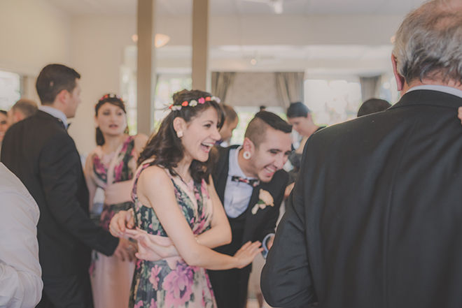 Guests dancing at wedding | Rose Garden Beach Wedding | Levien and Lens Photography