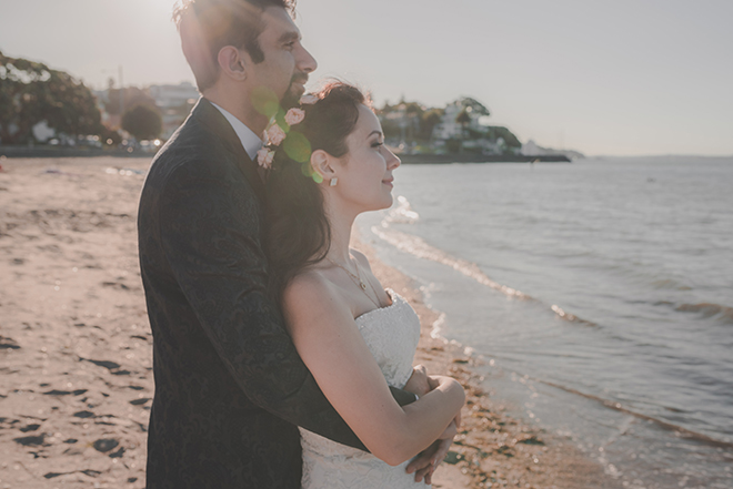 Groom and Bride standing on beach | Rose Garden Beach Wedding | Levien and Lens Photography