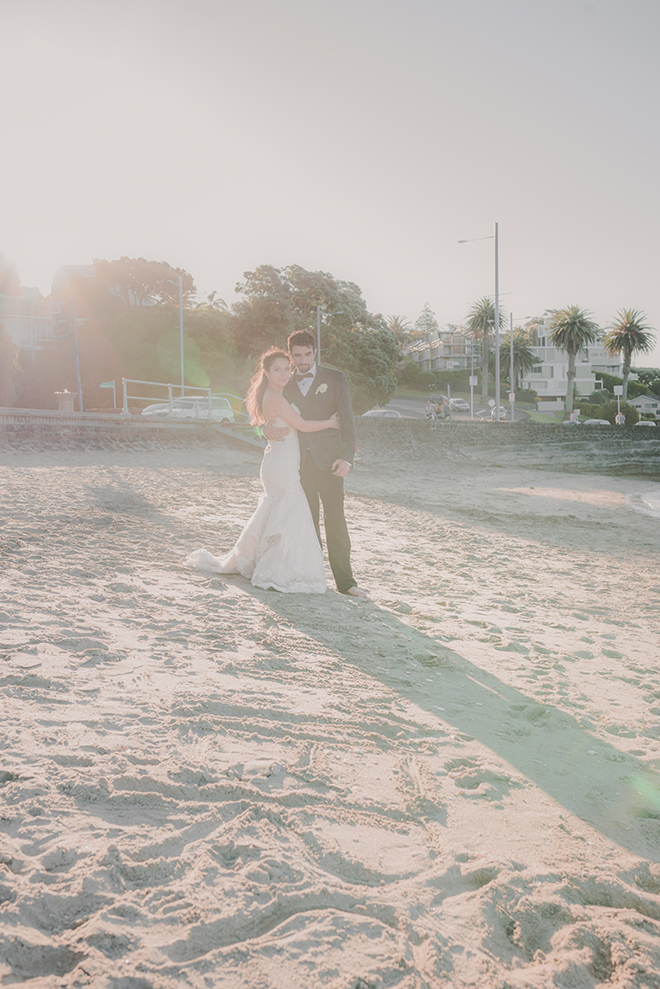 Bride and groom on beach | Rose Garden Beach Wedding | Levien and Lens Photography