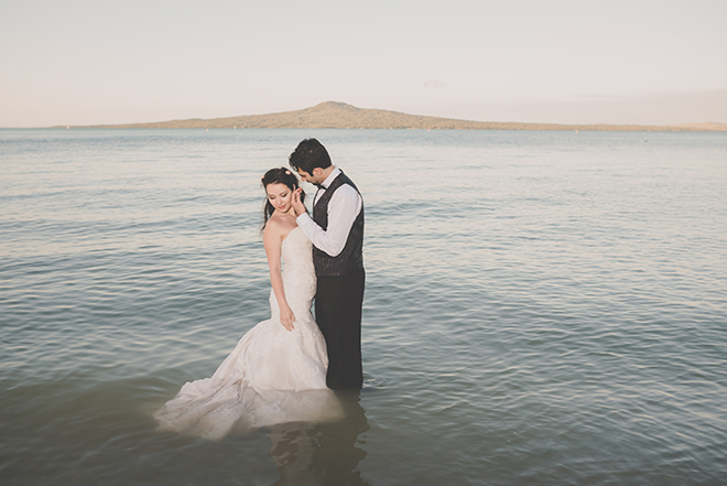 Bride and Groom standing in sea | Rose Garden Beach Wedding | Levien and Lens Photography