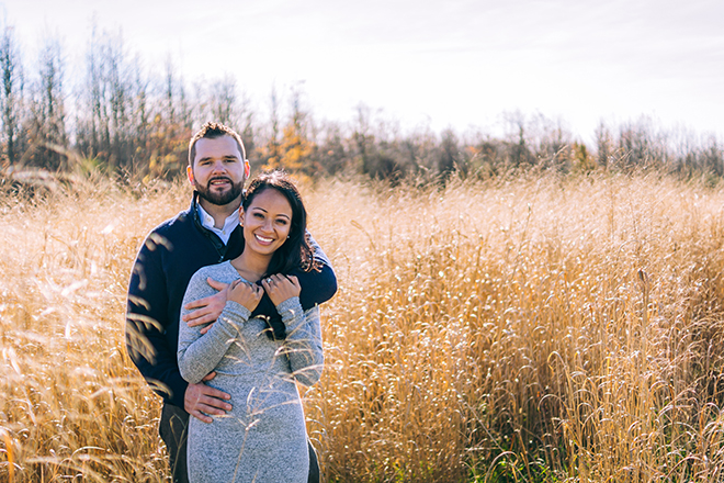 Engaged couple standing in field | Rustic Engagement | Anders Portfolio Photography
