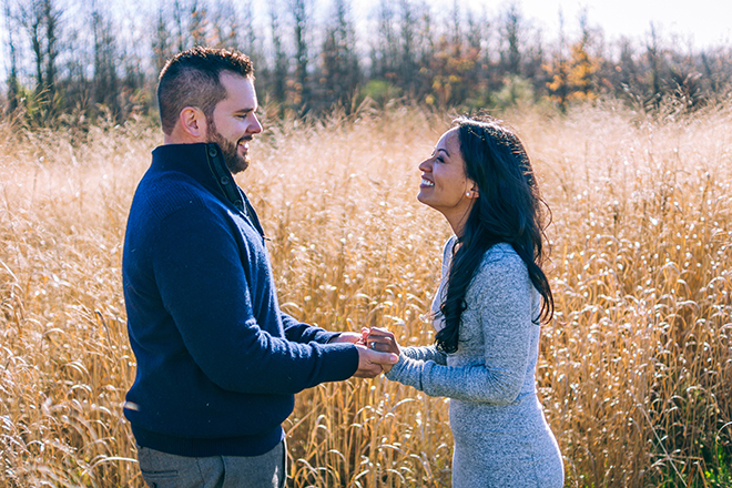 Couple holding hands in field | Rustic Engagement | Anders Portfolio Photography