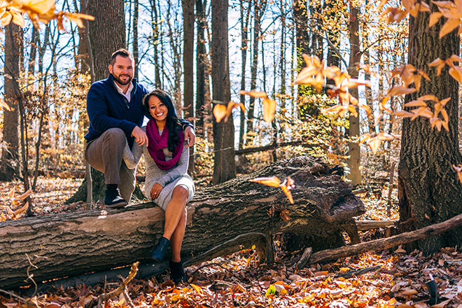 Couple sitting on tree trunk | Rustic Engagement | Anders Portfolio Photography