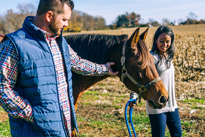 Bride and Groom walking with horse | Rustic Engagement | Anders Portfolio Photography