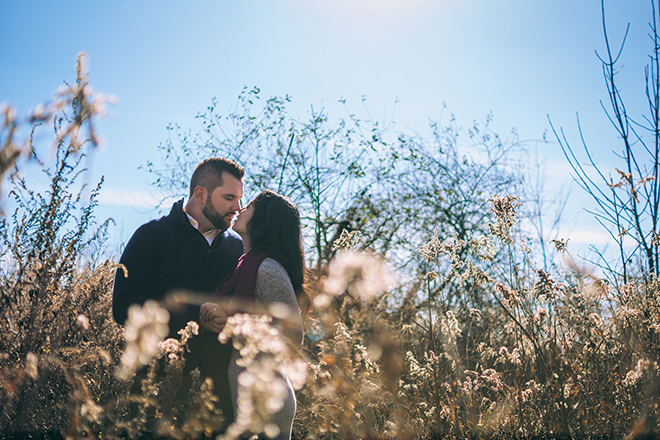 Couple kissing in field | Rustic Engagement | Anders Portfolio Photography