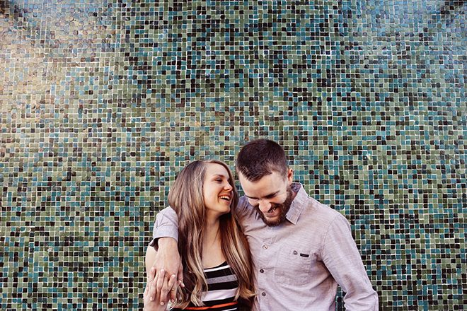 Couple standing infront of tiled wall | Modern Country Engagement | Brandy Swartz Photography